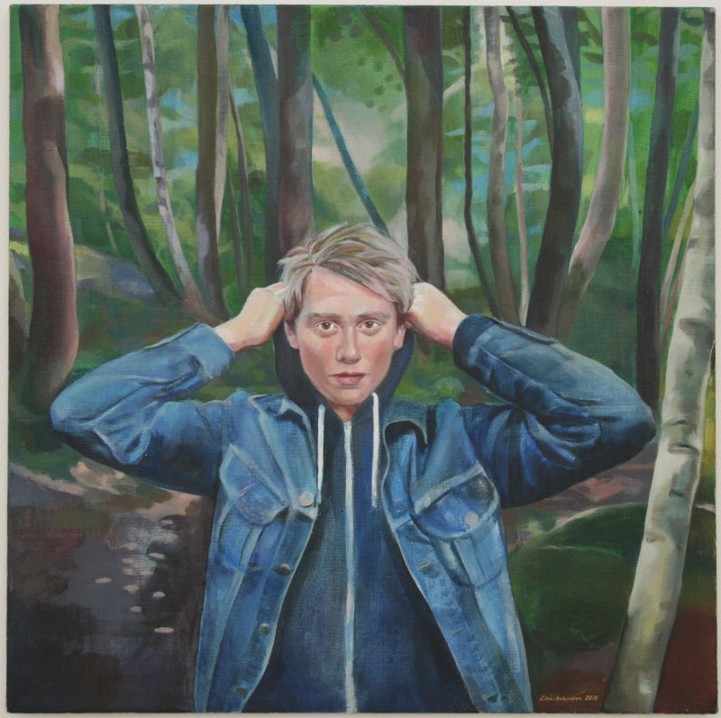 A man in the middle of a forest or trees
